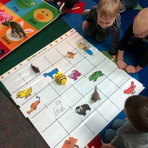 Kindergarteners work with Bee-Bot robot on the Bee-Bot mat
