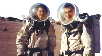 2 men dressed as astronauts on Mars