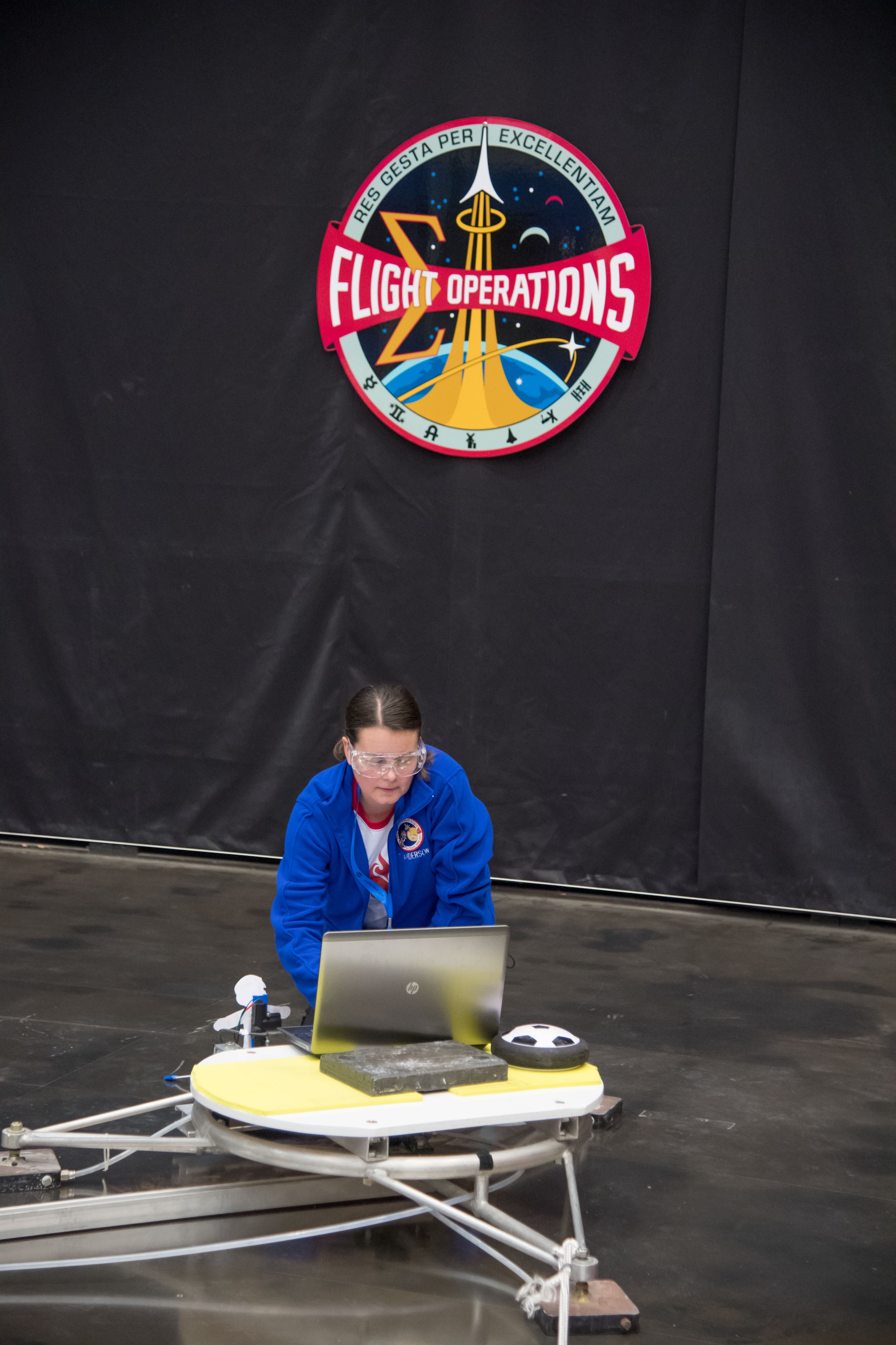 Tanya Anderson demonstrates her students' launch pad at NASA Microgravity Education event.