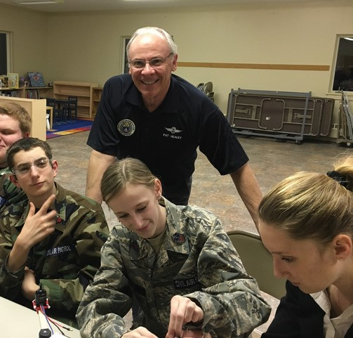 Capt. Patrick Healey works with cadets on an AE activity