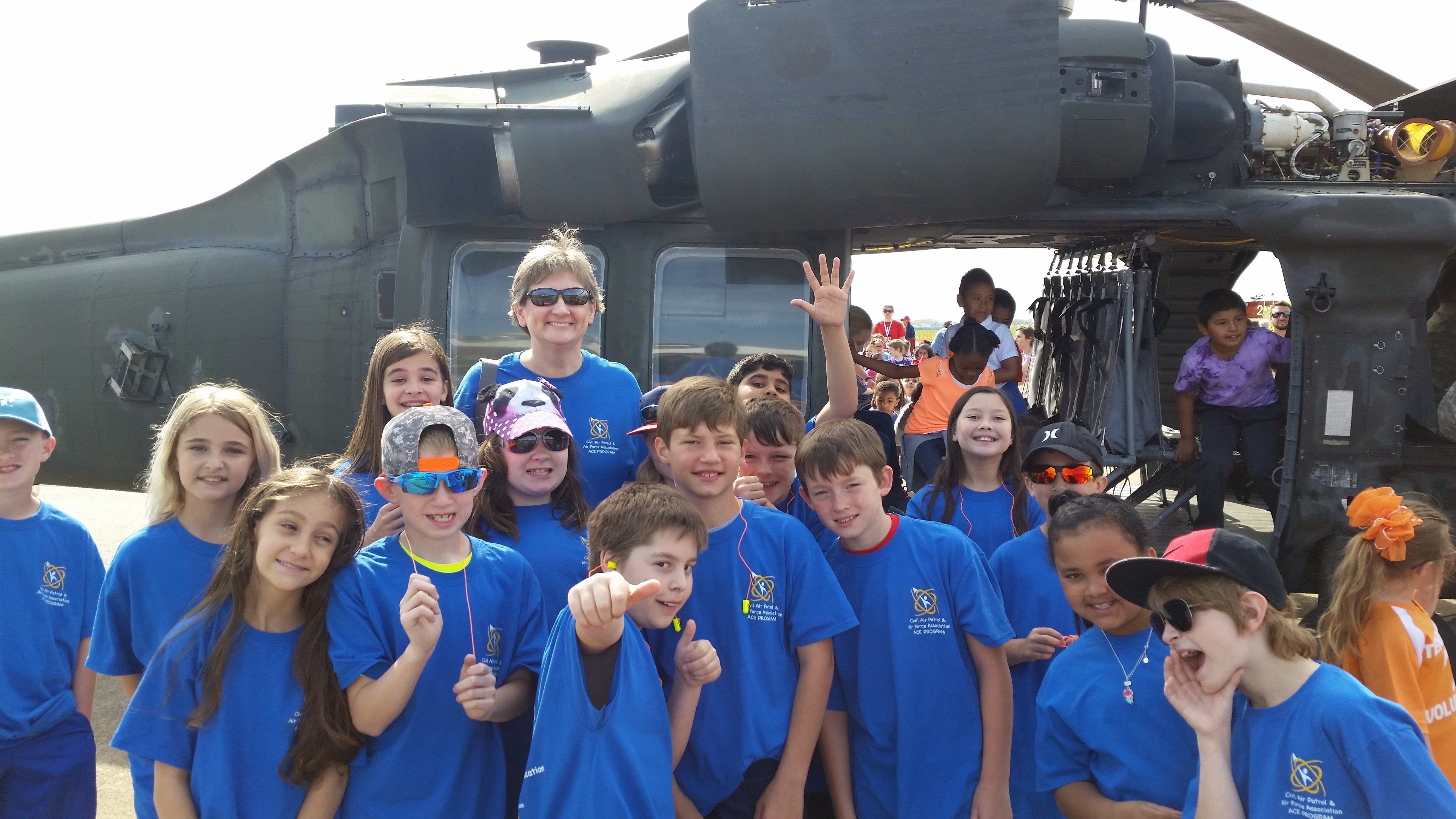 Suzanne Costner and her students tour static displays at an air show