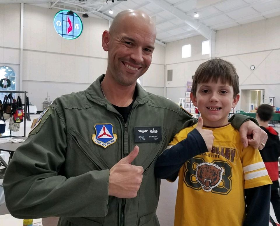Picture of Lt. Col. Schmuck and a student from Thrive afterschool program