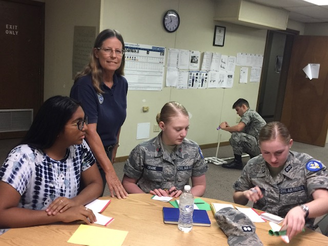 Lt. Col. Bonnie Hinck (Baldatti) works with cadets on an AE project